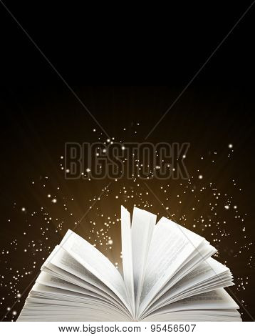 Open book and magic sparks on black background