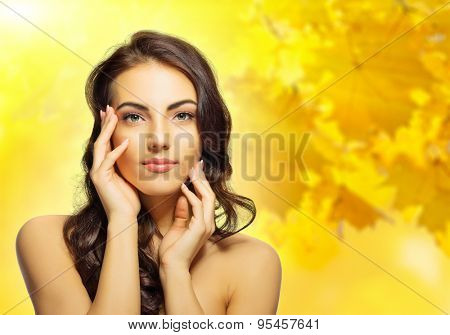 Young healthy girl on autumn background