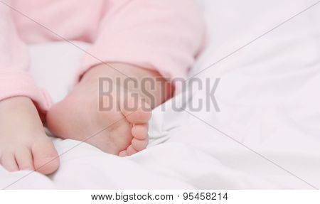 Close Up Little Foots Of Sleeping Cute Baby