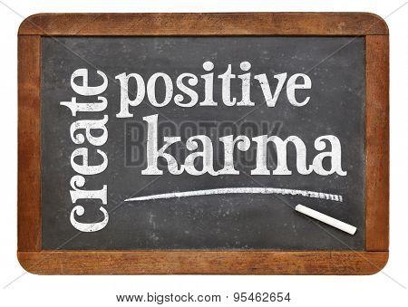 create positive karma - motivational text on a vintage slate blackboard
