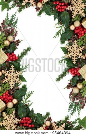 Christmas abstract background border with gold snowflake decorations, round and gift box baubles,  holly, ivy and fir over white.
