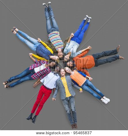 People Lying Down Diverse Group Unity Friendship Concept