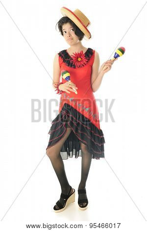 An attractive young teen girl in Mexican attire waiting to dance for Cinco de Mayo.  On a white background.
