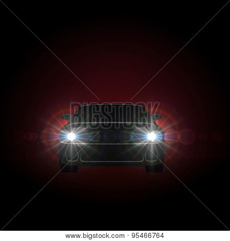 Bright car headlights shining from dark background with copy space.