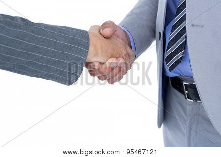 Businessman shaking hands with a co worker on white background