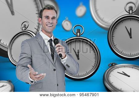 Businessman giving speech against blue background with vignette