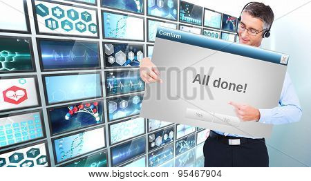 Happy businessman with headphone presenting a panel against confirm box