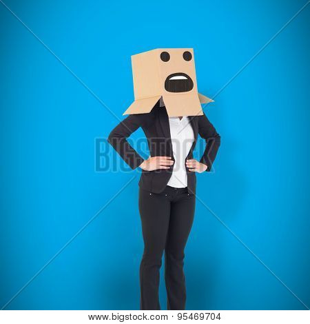 Businesswoman with box over head against blue background with vignette
