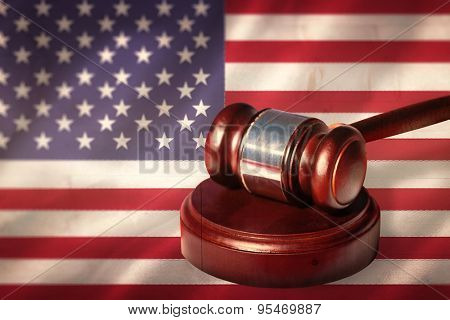 Hammer and gavel against digitally generated american national flag