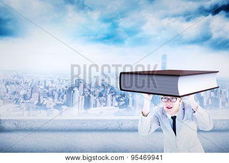 Businessman peeking against cityscape