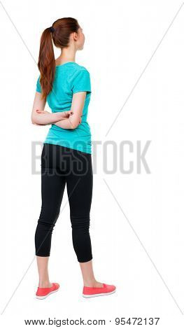 back view standing young beautiful woman. girl watching. Rear view people collection. backside view person. Isolated over white background. Sport girl standing with his hands crossed behind his back