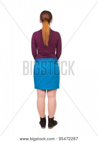 back view standing young beautiful  woman in jeans. girl  watching. Rear view people collection.  backside view person.  Isolated over white background.Girl in blue skirt is turning away from viewer.