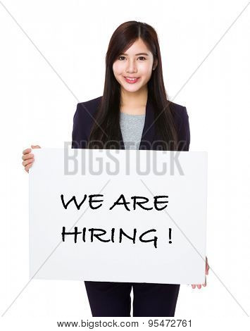 Businesswoman showing a placard showing with we are hiring phrases