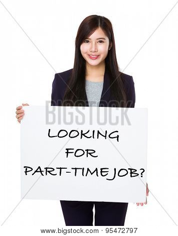 Confident businesswoman showing a placard showing with looking for part-time job phrases
