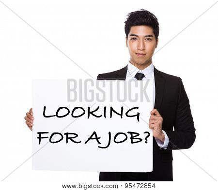 Asian businessman showing a placard showing with looking for a job phrases