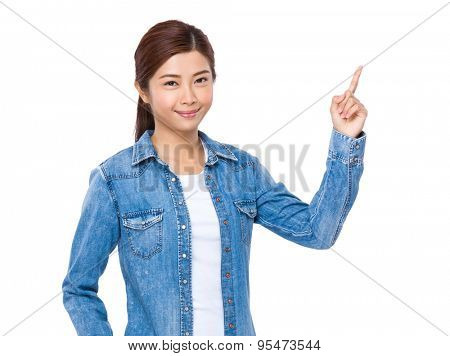 Young woman pointing finger upwards