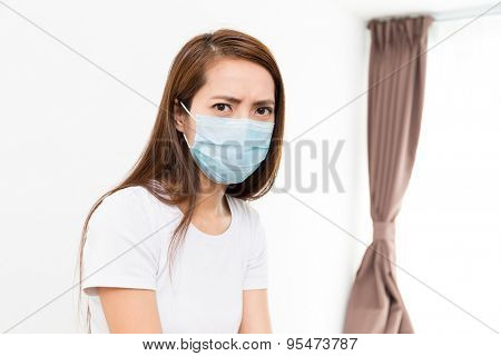 Asian woman wear with protective face mask at home