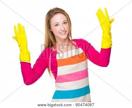 Young housewife wear with rubber gloves