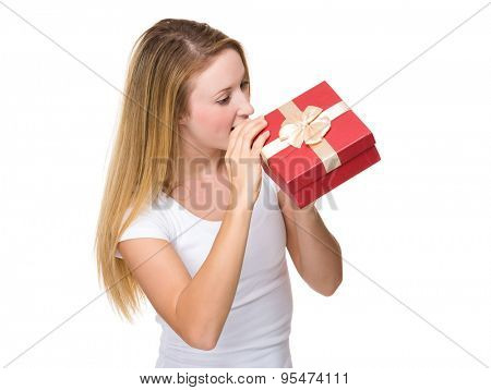 Young woman open her gift