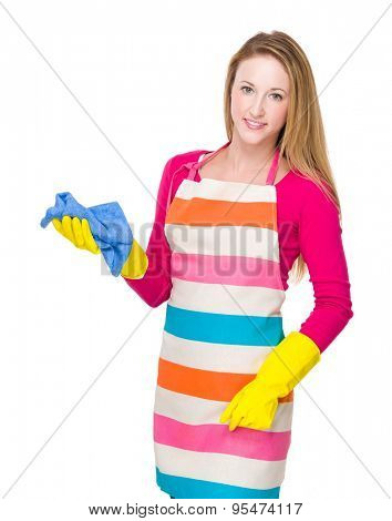 Caucasian housewife cleaning with rag