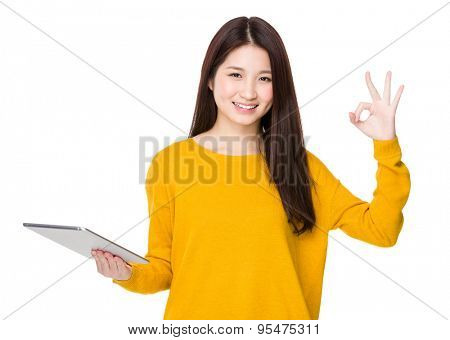 Asian woman hold with tablet and ok sign