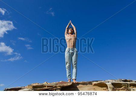 Full body handsome man doing yoga exercise in outdoors