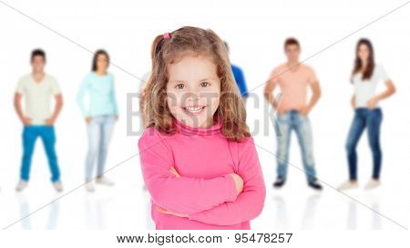Funny little girl with casual young people of background unfocused