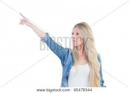 Blonde girl indicating something isolated on a white background