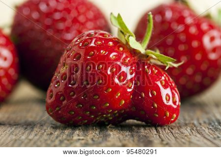 Strangely shaped double strawberry closeup