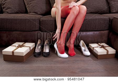 lady trying on several pairs of new shoes in the mall