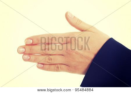 Young businesswoman shaking hand to welcome someone