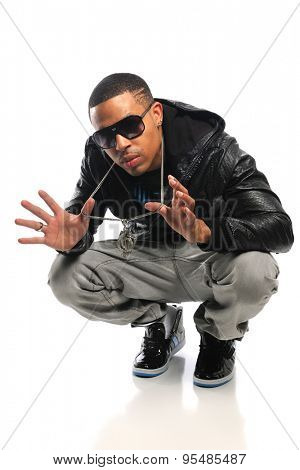 African American hip hop dancer showing jewelry isolated over white background