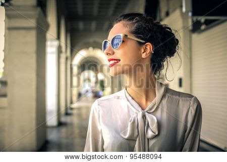 Fashionable woman walking in the city center