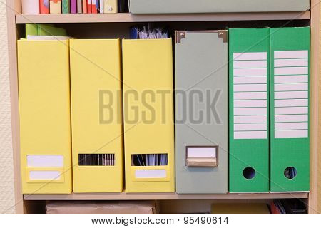 The image of folders on a shelf