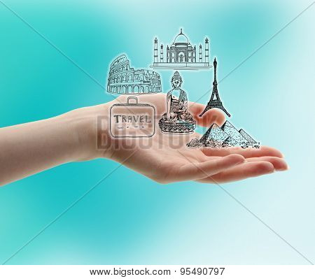 Female hand with drawings on blue background