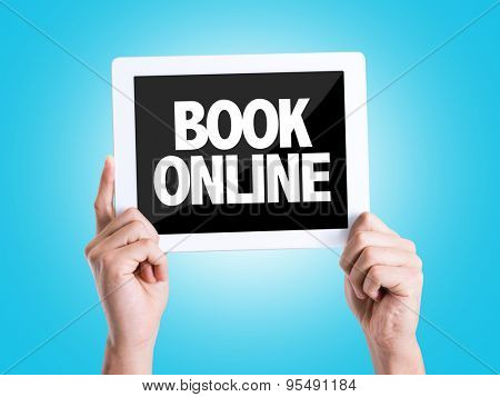Tablet pc with text Book Online with blue background