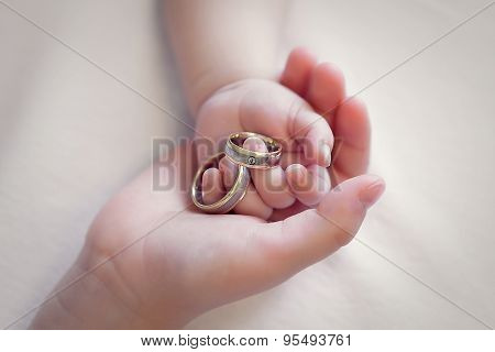 Children Hands Holding Gold Silver Rings