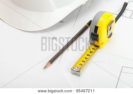 Measuring Tape, Construction Helmet And Pencil