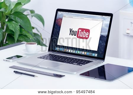 Youtube Logo On The Apple Macbook Pro Display That Is On Office Desk In Modern Office Work Place