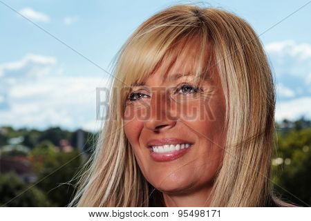 Melancholic Smile Of An Aging Lady