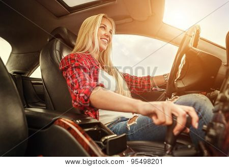 Young Woman Drives A Car