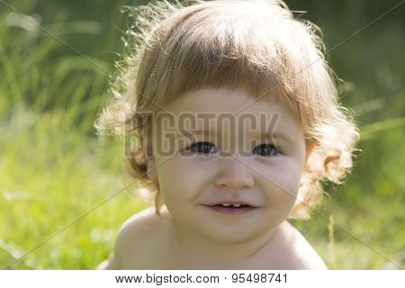 Little Boy On Green Grass