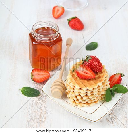 Jar Of Honey, Ripe Strawberries And Waffles