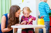 picture of daycare  - Young mother and her daughter drawing together - JPG