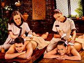 pic of panchakarma  - Couple  having oil Ayurveda spa treatment with herbal ball - JPG