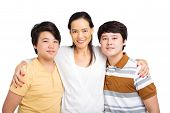 foto of korean  - Portrait of Embracing Korean family of three - JPG