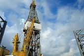 picture of offshore  - Offshore Drilling Rig with Working Cranes on Cloudy Day - JPG