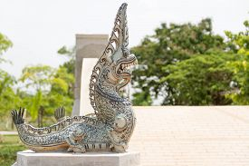 stock photo of serpent  - Serpent on the stone podium in Thailand - JPG
