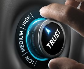 picture of trustworthiness  - Man fingers setting trust button on highest position - JPG