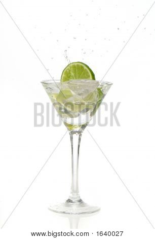 Lime Splashing Into A Cocktail Glass
